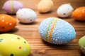 Easter eggs on wooden background a Stock Image