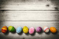 Easter eggs on wooden background hand painted colorful rustic planks Stock Photos