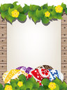 Easter eggs on the wooden fence background painted with sheet of paper and flowers Stock Images