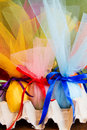 Easter eggs wrapped in tulle with a satin ribbon detail on the blue one spring rebirth Royalty Free Stock Images
