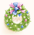 Easter Festive Grass Wreath with Bow Egg Flower on Beige Royalty Free Stock Photo