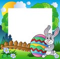 Easter frame with bunny holding egg Royalty Free Stock Image