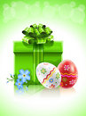 Easter gift with bow flower and painted eggs Stock Image