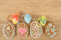 Easter ginger breads painted egg wooden background Stock Photography