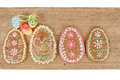 Easter ginger breads painted egg wooden background Stock Images