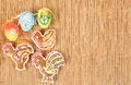 Easter gingerbreads painted egg wooden background Stock Photo