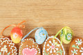 Easter gingerbreads painted egg wooden background Stock Photography