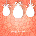 Easter greeting card with eggs hanging on ribbons Stock Photo
