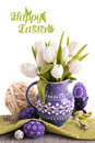 Easter greeting card with white tulips in purple jug and matchin ceramic matching eggs top of the picture is isolated on Stock Photo