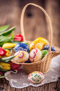 Easter. Hand made painted easter eggs in basket and spring tulips