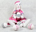 Easter handmade bunny female holding decorated egg Stock Image