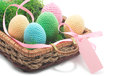 Easter handmade eggs with grass five in basket pink band isolated on white background crochet Royalty Free Stock Images