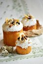 Easter holiday cake with quail eggs nuts dried fruits on white tablecloth Royalty Free Stock Photo