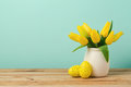 Easter holiday concept with tulip flowers and eggs decorations on wooden table