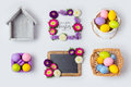 Easter holiday eggs decorations, flower frames and basket for mock up template design. View from above. Royalty Free Stock Photo