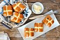 Easter Hot Cross Buns, overhead scene on rustic wood Royalty Free Stock Photo
