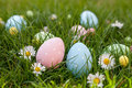 Easter hunt different color egg on a grass Stock Images