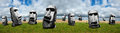 Easter island statues abstract panoramic or panorama banner concept with a series of in a image with a meadow of green grass and Royalty Free Stock Photos