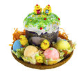 Easter kulich with painted eggs and funny chickens set on a straw tray isolate Royalty Free Stock Photos