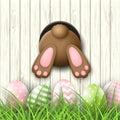 Easter motive, bunny bottom andeaster eggs in fresh grass on white wooden background, illustration