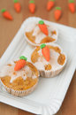 Easter muffins with marzipan carrots Royalty Free Stock Image
