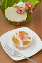 Easter muffins with marzipan carrots Royalty Free Stock Images