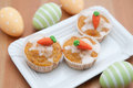 Easter muffins with marzipan carrots Royalty Free Stock Photography