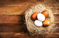 Easter nest with eggs on wooden background with copyspace whit white and brown closeup rustic style concept Stock Photos