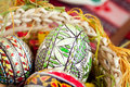 Easter painted eggs in traditional basket Stock Image