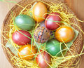 Easter painted eggs in traditional basket Royalty Free Stock Photos