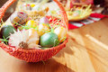 Easter painted eggs in traditional basket Royalty Free Stock Photo
