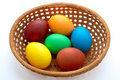 Easter  painted eggs in webbed wooden plate Royalty Free Stock Photo