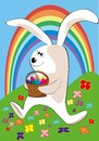 The easter rabbit bearing a basket of Easter eggs Stock Photo