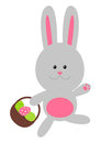 Easter rabbit with color eggs on white background Stock Image