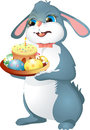 Easter rabbit holds cake. Royalty Free Stock Photo