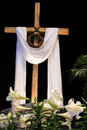 Easter resurrection lilies cross and crown of thorns white a wooden symbolic signifying the death jesus christ Stock Photos