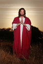 Easter risen prayer hands jesus christ full body praying image back lit with in offering a loving blessing and deep love and Royalty Free Stock Photos