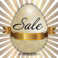Easter sale background with decorated white egg and golden ribbon