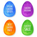Easter sale offer discount and price in eggs banners four colors labels with spring daisy flowers business shopping holiday Stock Photography