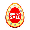 Easter sale in red egg shape label with flowers Royalty Free Stock Photos