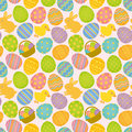 Easter seamless pattern background of elements eggs bunny chick and basket Stock Images