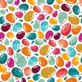 Easter seamless pattern of colorful eggs and feathers