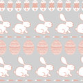Background for Happy Easter Day. Easter seamless vector texture. Cute rabbits, eggs and carrots pattern. Royalty Free Stock Photo