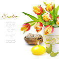 Easter set with spring tulips and candle Stock Photo