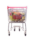 Easter shopping trolley with many decorative eggs on white Royalty Free Stock Photography
