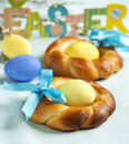 Easter small sweet bread wreath and colorful eggs Stock Images