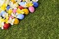 Easter eggs spring corner background border, flower bed, green grass copy space