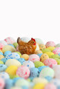 Easter still life. Figure of hen sitting on a colored eggs. Royalty Free Stock Photo
