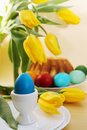 Easter still life with tulips passover holiday eggs flowers and cake Stock Image