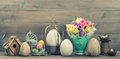 Easter stillife tulip flowers and colored eggs decoration with retro style toned picture Royalty Free Stock Image